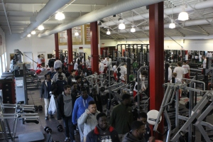 Football team visits Cornell's weightroom.