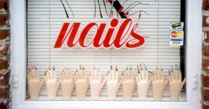 Workers in nail salons are paid below minimum wage and exposed to toxic chemicals.
