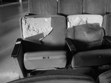 Ripped seats in the auditorium